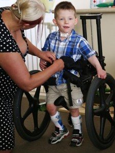 Lachlan Neylan suffered brain damage after being administered a fluvax vaccine which is banned in kids under 5, his parents Adrian and Stacey have turned their Sydney home into a rehab facility to help him learn to walk and talk again. Lachlan is strapped into his walker to help get him walking correctly again.