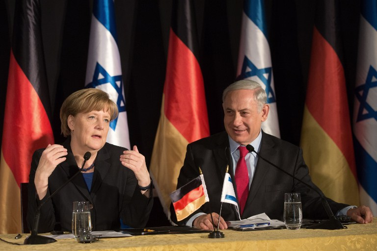 German Chancellor Angela Merkel and Israeli Prime Minister Benjamin Netanyahu attend a joint press conference after their cabinets held a meeting at the King David hotel in Jerusalem on February 25, 2014. Merkel arrived in Israel with her cabinet yesterday to discuss nuclear talks with Iran and to encourage Prime Minister Netanyahu to reach a two-state solution with the Palestinians. AFP PHOTO/MENAHEM KAHANA