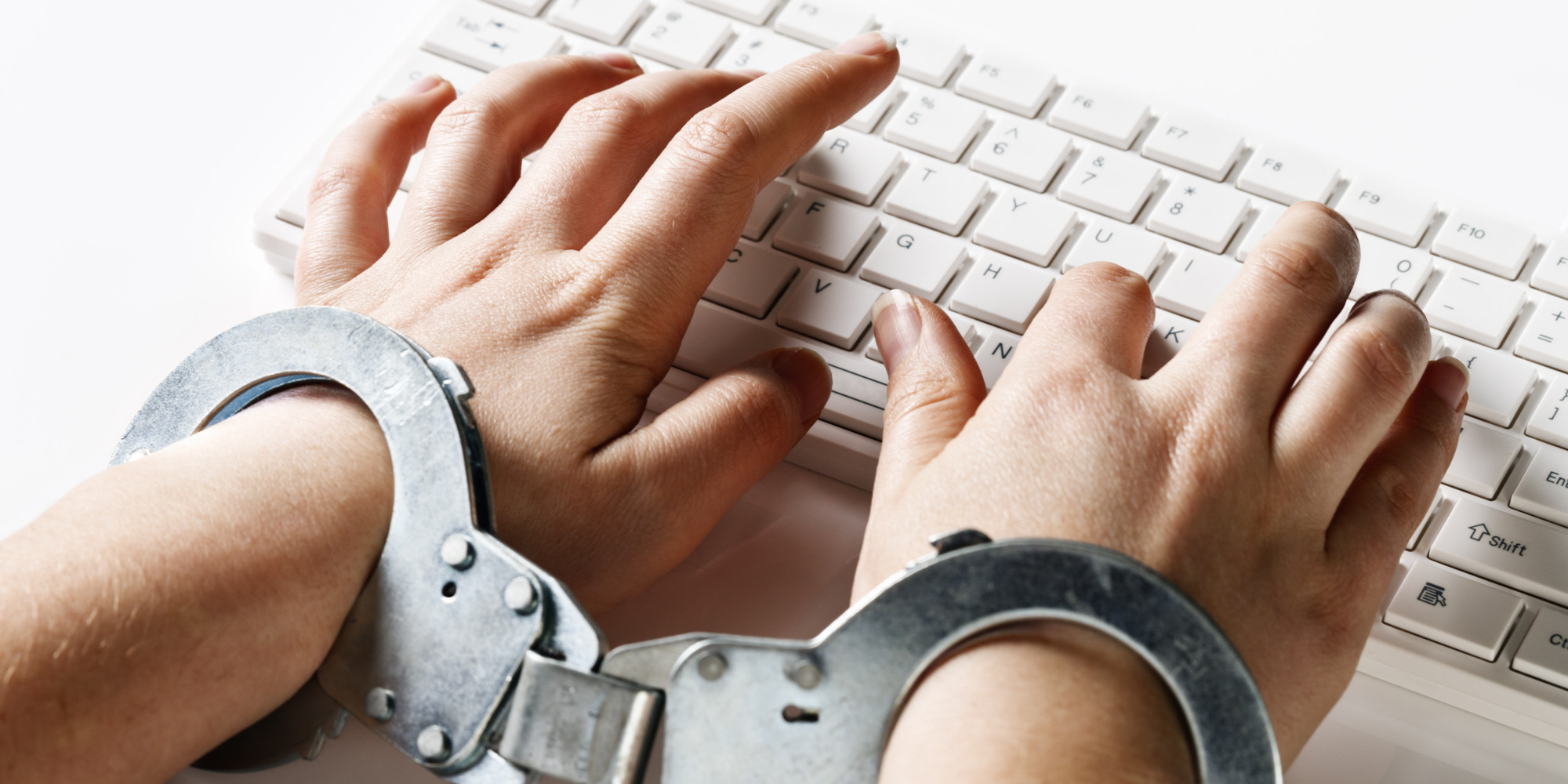 Handcuffed to her computer: very demanding job or censorship