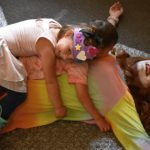 Photos Show Kids Laying on Top of Drag Queen at 'Drag Queen Story Time' Event