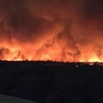 The face in the fire: Dairy farmer claims to have spotted the DEVIL lurking in bushfire clouds in Victoria