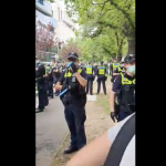 PROTESTERS ENCIRCLE POLICE AT ANTI-MANDATORY VACCINATION PROTEST IN MELBOURNE, AUSTRALIA