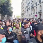 POLICE MARCHING WITH PROTESTERS IN FRANCE