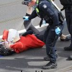 Australian Police Bash and Pepper spray 70-year old woman?
